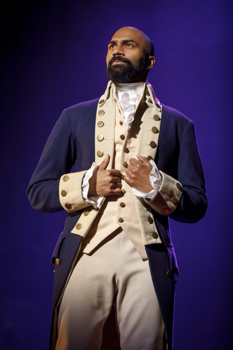 Aaron Burr is dressed in his military uniform ready to join the revolution.